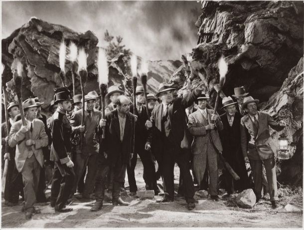 The torch-bearing mob, a staple of horror films of the era.
