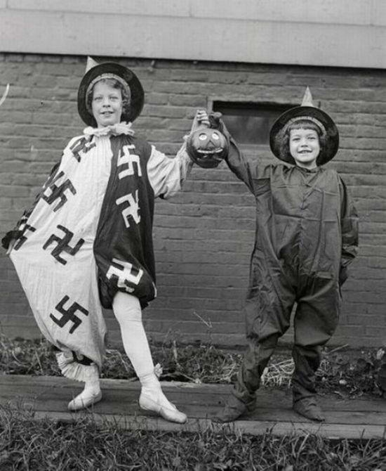 A Halloween costume with a swastika motif is probably not a good idea.
