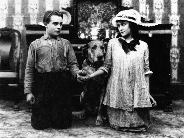 Bobby Vernon, Teddy the dog, and Gloria Swanson in Teddy at the Throttle
